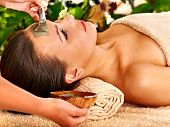 pic of beauty parlour  - Woman with clay facial mask in beauty spa - JPG