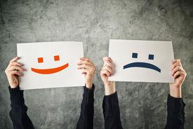 stock photo of emoticon  - Happy and sad face - JPG