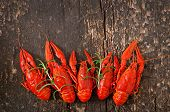 image of crawfish  - Fresh boiled crawfish on the old wooden background - JPG