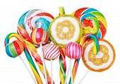 stock photo of lollipop  - Colorful candies and lollipops isolated on white background - JPG