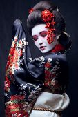 pic of sakura  - young pretty geisha in kimono with sakura and decoration - JPG
