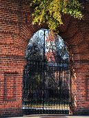 foto of derelict  - Derelict ruins of the Columbia State Mental Hospital in Columbia South Carolina sits behind locked black metal gate - JPG