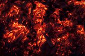 stock photo of ember  - Full frame shot of glowing embers in hot red color - JPG