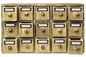 picture of primite  - primitive wooden apothecary or catalog cabinet with partially open drawers and blank labels in bronze holders - JPG