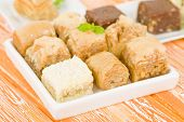 pic of phyllo dough  - Baklava - Middle Eastern sweet pastry and nuts selection on an orange background. ** Note: Shallow depth of field - JPG