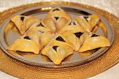 foto of torah  - magen david made from Hamantaschen cookies for Jewish festival of Purim