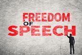 image of freedom speech  - Asian businessman write text on wall - JPG