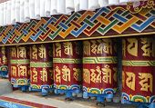 picture of buddhist  - Colorful Buddhist Prayer wheels at monastery  - JPG