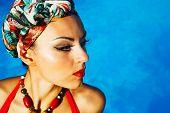 foto of turban  - Beautiful fashionable woman near the pool wearing colored turban - JPG