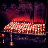stock photo of enlightenment  - Burning candles in Buddhist temple  - JPG