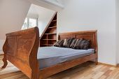 picture of attic  - View of vintage bed in the attic - JPG