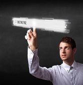 picture of web surfing  - Young man touching web browser address bar with www sign  - JPG