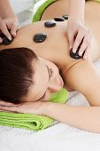 image of stone-therapy  - Girl on a stone therapy - JPG