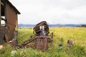 foto of derelict  - Abandoned derelict tractor in advanced stage of rusting to pieces - JPG
