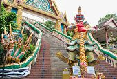 foto of guardian  - Big guardian sculpture and exterior decoration at rang hill temple phuket thailand - JPG