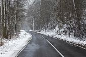 foto of slippery-roads  - Snowy road in winter landscape - JPG