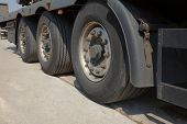 picture of big-rig  - Wheels of the trailer of a big truck - JPG