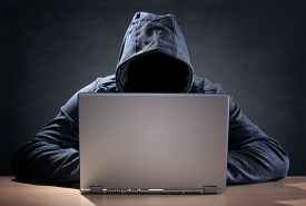 foto of hoodie  - Computer hacker stealing data from a laptop concept for network security - JPG