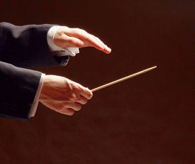 stock photo of conduction  - Conductor conducting orchestra isolated on black background - JPG