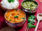 stock photo of paneer  - Photo of an Indian meal of Butter Chicken rice and Saag Paneer - JPG
