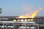 picture of gas-pipes  - Gas and oil pipes escaping with fire - JPG