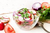 picture of chinese parsley  - Spring salad with radishes cucumber Chinese cabbage and red onion closeup on a white wooden background - JPG