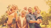 picture of extended family  - Portrait of cheerful extended family standing at the park - JPG