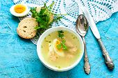 picture of meatball  - a bowl of soup with meatballs and half eggs with parsley on a wooden tray - JPG