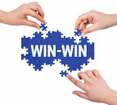foto of win  - Hands with puzzle making WIN - JPG