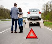 stock photo of tow-truck  - Couple near tow - JPG