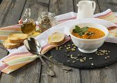 pic of ginger bread  - Soup of carrots with ginger on old table background - JPG