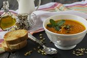 foto of ginger bread  - Soup of carrots with ginger on old table background - JPG