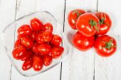 foto of plum tomato  - tomatoes in a glass jar on a white table - JPG