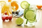 stock photo of masonic  - Detox water with various types of fresh fruit and vegetables in mason jars on a table - JPG
