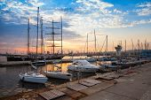 picture of sailing-ship  - Sailing ships and yachts stand moored in Varna port at the sunset - JPG