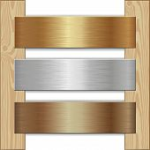 pic of plaque  - golden silver and bronze plaques nailed to wooden planks - JPG