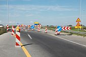 image of road sign  - Road signs in a highway on reconstruction - JPG