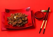 stock photo of stir fry  - Vietnamese beef stir fry served on a red background - JPG