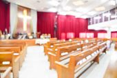 stock photo of church interior  - Blurred interior of empty church with empty pews - JPG