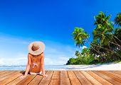 stock photo of sunbather  - Woman Sunbathe Sunny Summer Beach Relaxing Concept - JPG