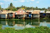 foto of early morning  - Colorful squatter shacks and houses in a Slum Urban Area in early morning Ho Chi Minh City Vietnam - JPG