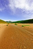 pic of dirt road  - Dirt Road in the Valley of the Cantabrian Mountains in Spain - JPG