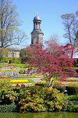 stock photo of chad  - View of The Dingle formal garden in Quarry Park during the Springtime with St Chads church to the rear Shrewsbury Shropshire England UK Western Europe - JPG