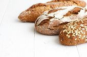 image of whole-grain  - Mixed whole grain health breads on rustic white painted wood - JPG