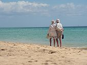foto of old couple  - old couple walking on the beutiful beach - JPG