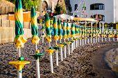 foto of marina  - Closed parasols in a row on the Marina di Cassano beach - JPG