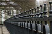 picture of spike  - Long line of wrought-iron fence retro spikes ** Note: Visible grain at 100%, best at smaller sizes - JPG