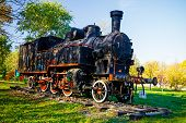 picture of time machine  - Steam locomotive is exposed in city park detail of ancient time - JPG
