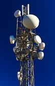 picture of antenna  - Communication antenna tower with various antennas on blue sky - JPG