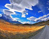 foto of incredible  - Gray dirt road in the Chile National Park  - JPG
